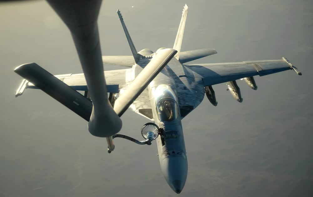 A US Navy F-18E Super Hornet receives fuel from a KC-135 Stratotanker over northern Iraq after conducting airstrikes ias part of US led coalition airstrikes on the Islamic State group and other targets in Syria.