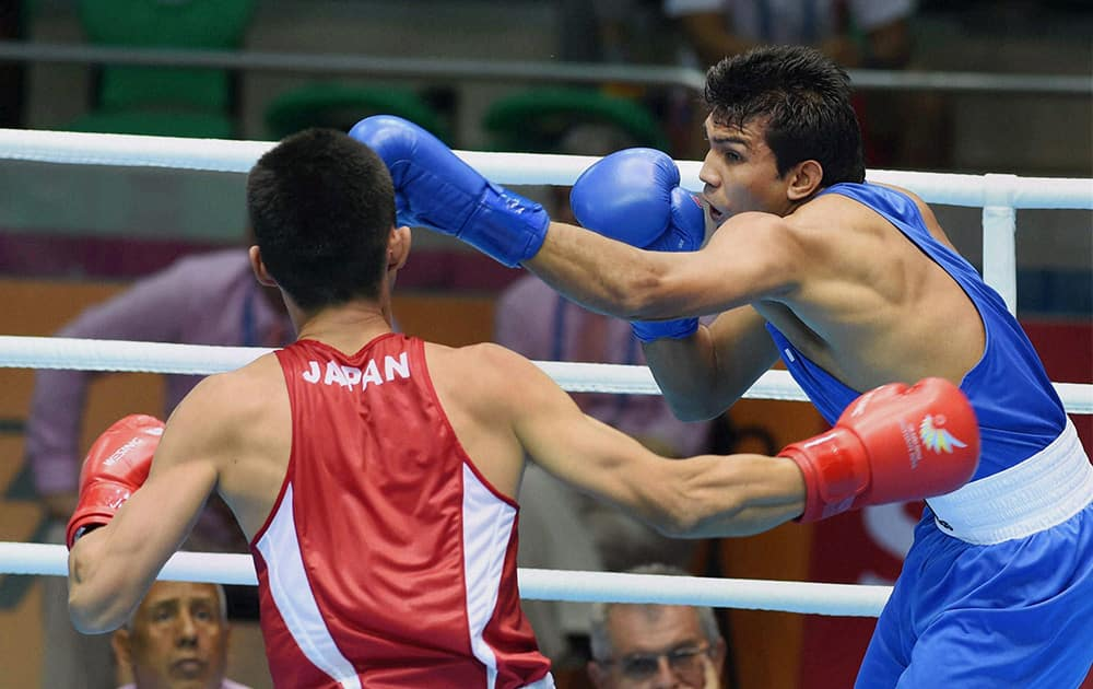 Pugilist Manoj Kumar punches at Japans Masatsugu Kawachi during preliminaries session 4 of the mens light fly (46-49 kg) category boxing event at the 17th Asian Games in Incheon, South Korea.