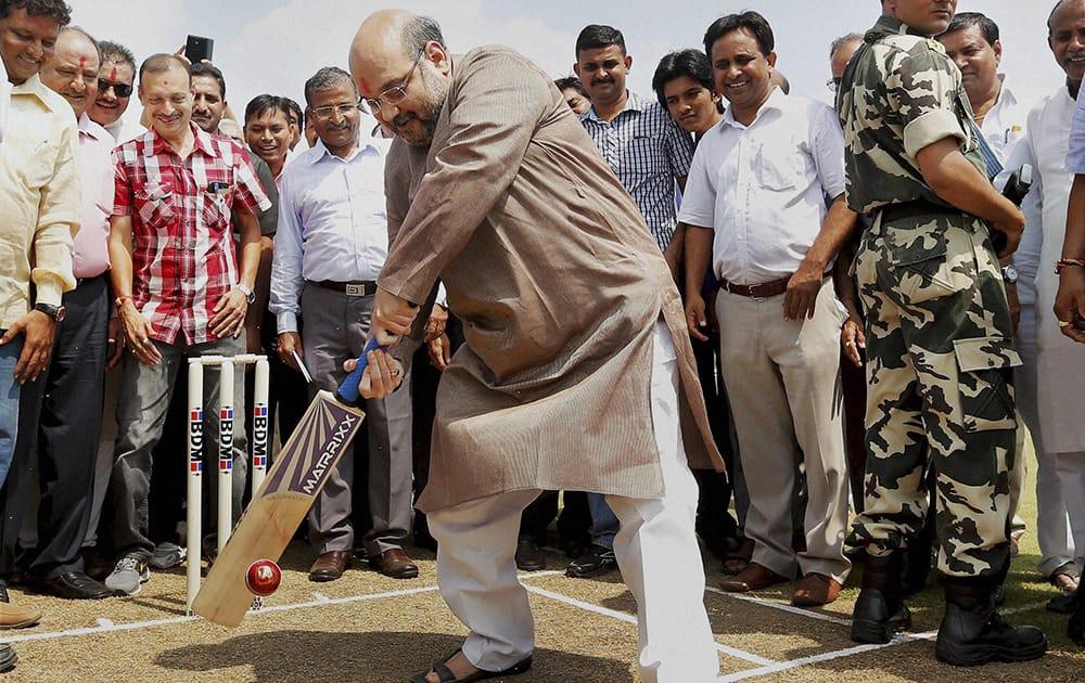 Bharatiya Janta Party President Amit Shah bats to inaugurate Gujarat Cricket Association ground in Ahmedabad.