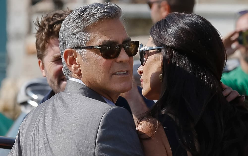 George Clooney and Amal Alamuddin arrive in Venice, Italy. Clooney, 53, and Alamuddin, 36, are expected to get married this weekend in Venice, one of the world's most romantic settings.