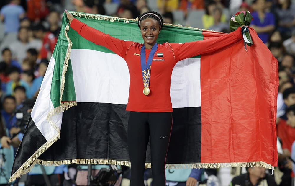 Alia Mohhammed Saeed Mohammed of the UAE celebrates on the podium after receiving her gold medal for the women's 10,000 meters final at the 17th Asian Games in Incheon, South Korea.