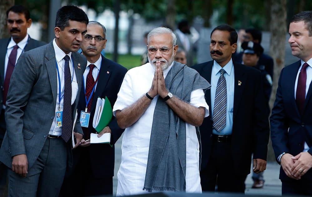 Prime Minister Narendra Modi of India, center, arrives for a visit to the National September 11 Memorial.