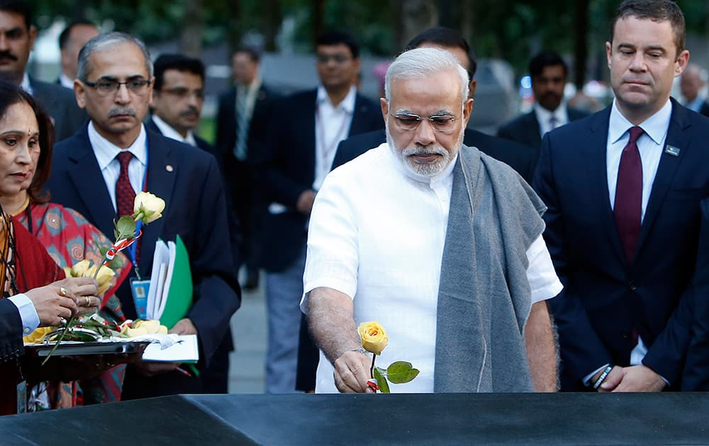 Prime Minister Narendra Modi of India lays roses on the names of Indian victims of the Sept. 11 attacks during a visit to the National September 11 Memorial, in New York.