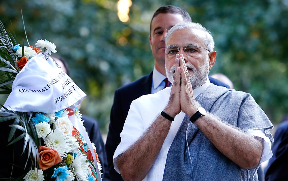 Prime Minister Narendra Modi of India gestures after laying a wreath at the base of the Survivor Tree during a visit to the National September 11 Memorial, in New York.
