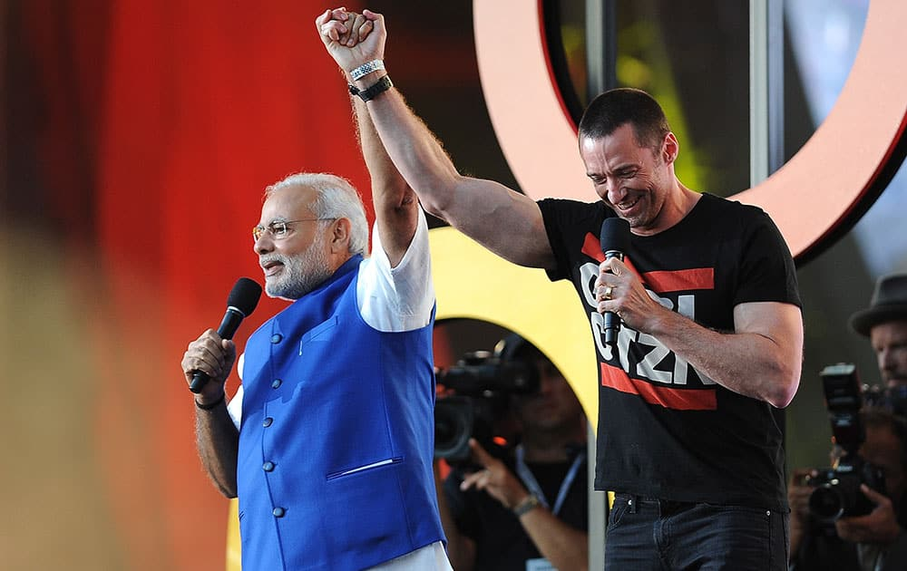 Prime Minister of India Narendra Modi, left and Hugh Jackman speak at the 3rd Global Citizen Festival at Central Park in New York.