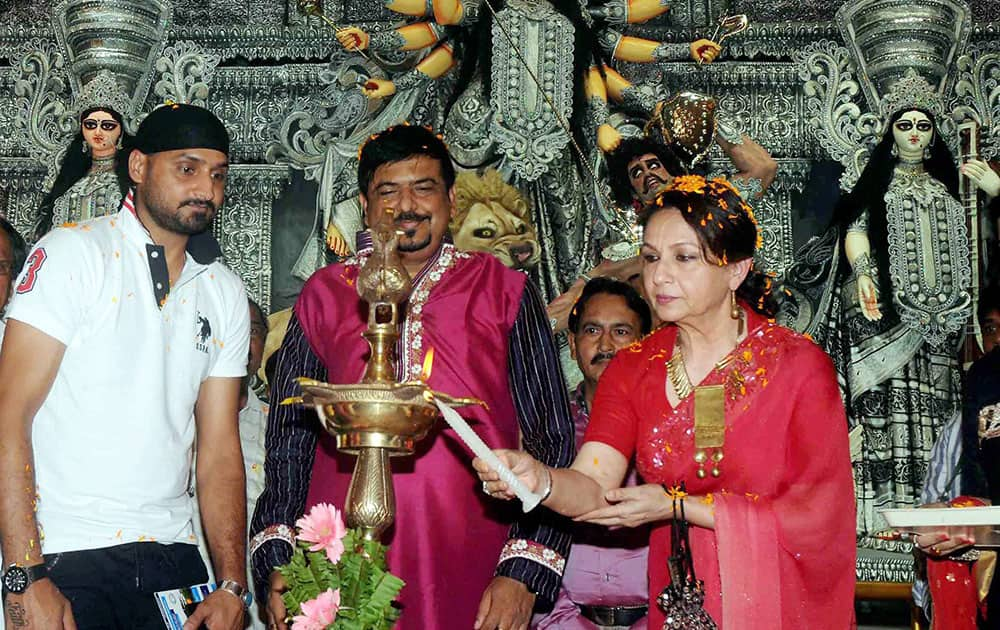 Actress Sharmila Tagore (R) and cricketer Harbhajan Singh on the occasion of Maha Panchami at Sreebhumi Sporting pandal, in Kolkata.