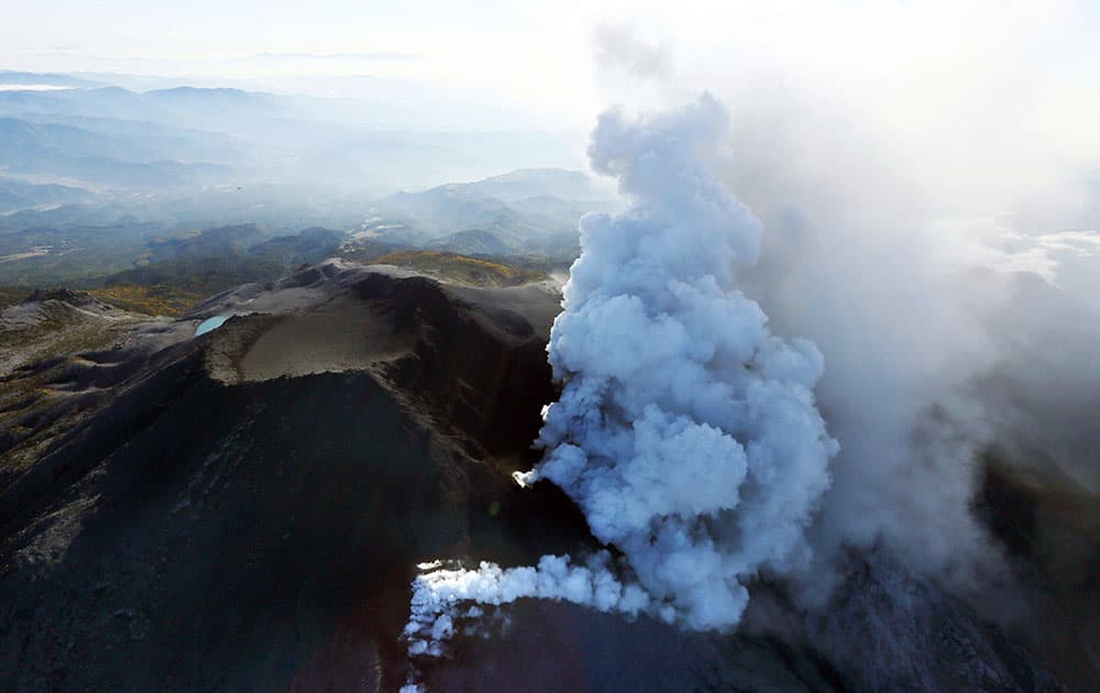 Plumes of smoke and ash billow from Mount Ontake as it continues to erupt in central Japan.