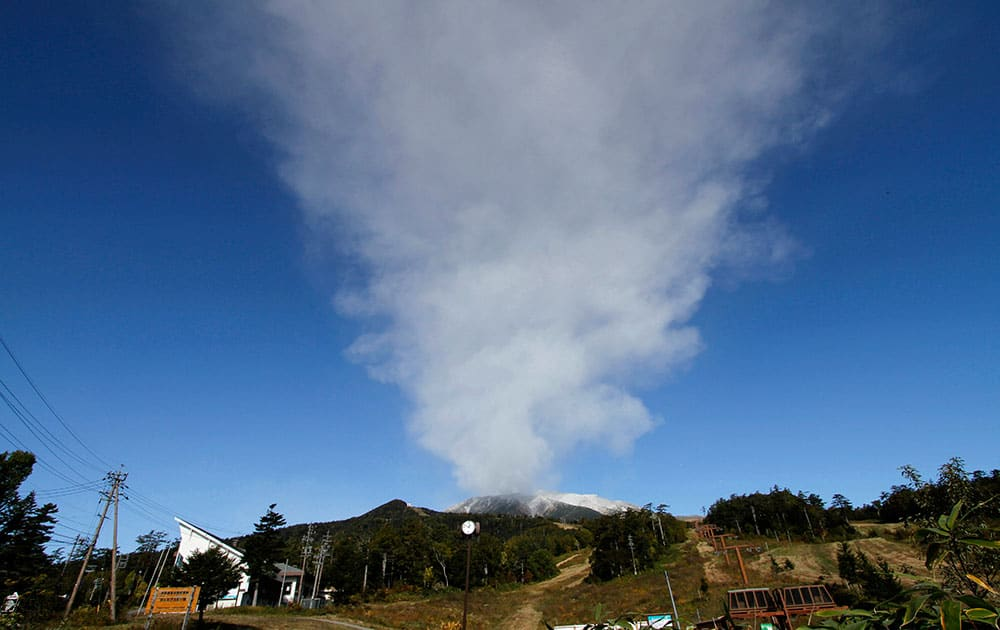 Plumes of smoke and ash billow from Mount Ontake as it continues to erupt for the third day in Otaki village, in Nagano prefecture, Japan.