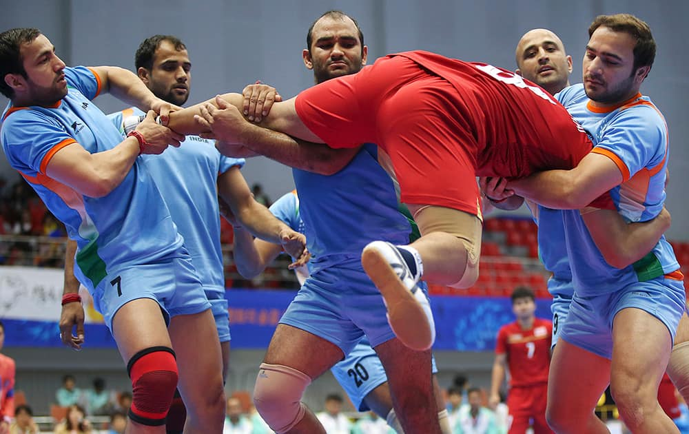 Thailand's Phuwanai Wannasaen, is caught by India team, during the men's team kabbadi preliminary match at the 17th Asian Games in Incheon, Korea.