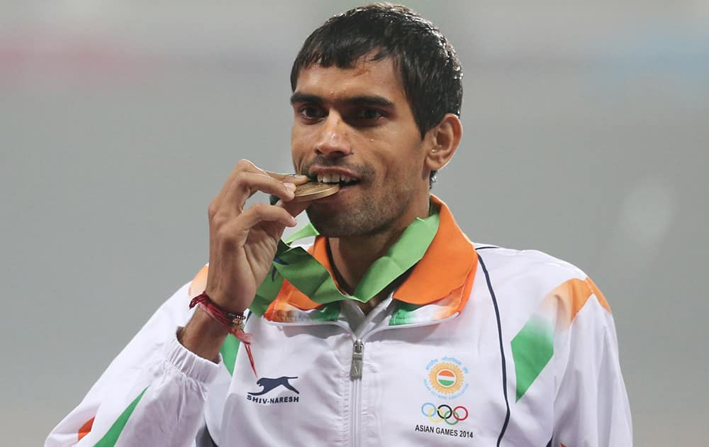Bronze medalist Naveen Kumar, from India, stands on the podium during men's 3000m steeplechase medal ceremony at the 17th Asian Games in Incheon, South Korea.