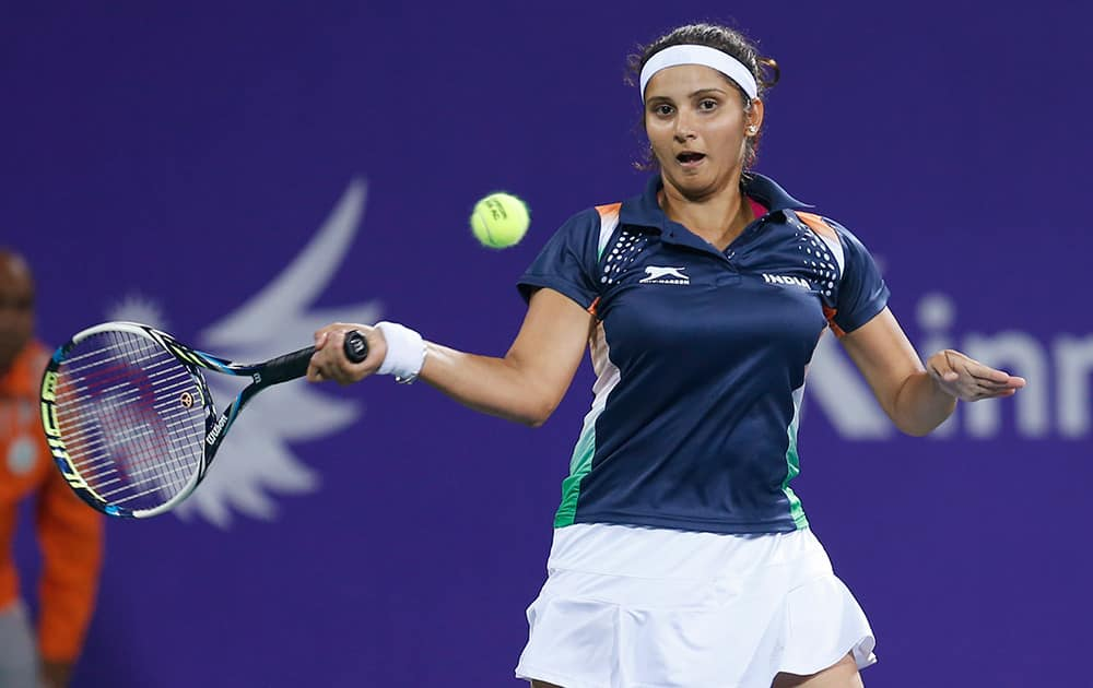 Sania Mirza returns a shot during the mixed doubles gold medal tennis match against Taiwan's Peng Hsien Yin and Chan Hao Ching at the 17th Asian Games in Incheon, South Korea.