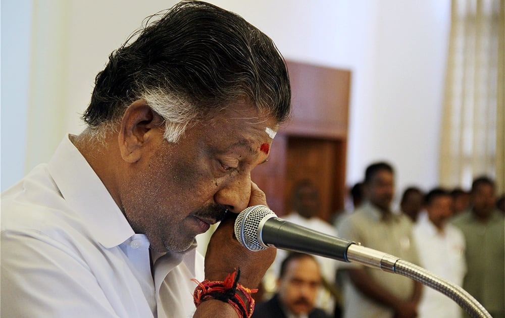 AIADMK leader O Panneerselvam gets emotional while taking oath as Tamil Nadu Chief Minister in absence of jailed party chief J Jayalalithaa at Raj Bhavan, Chennai.