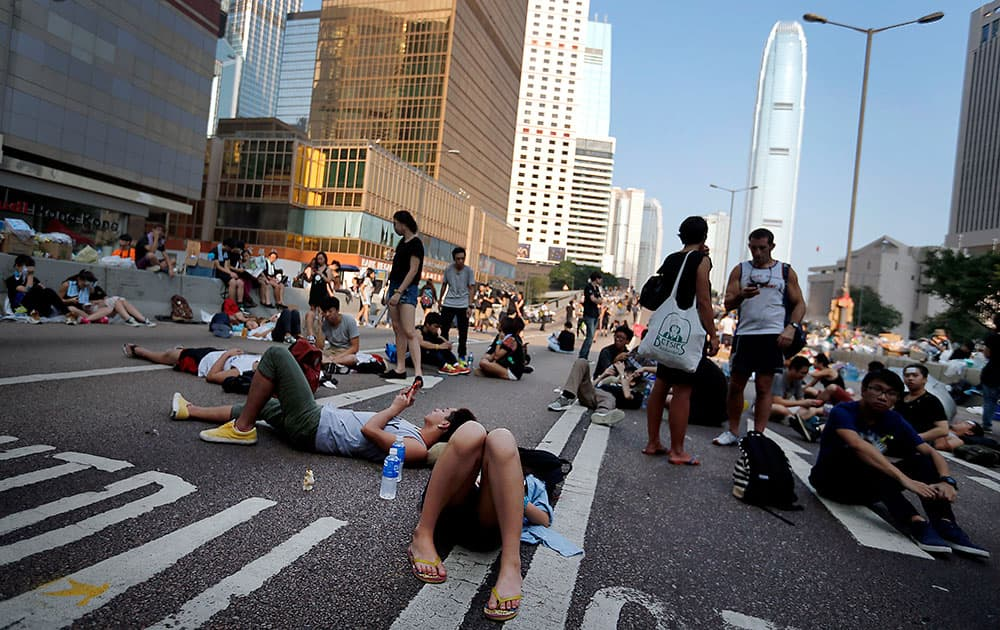 Student activists sleep on a road leading to the financial district, where pro-democracy activists have gathered and made camp, in Hong Kong.