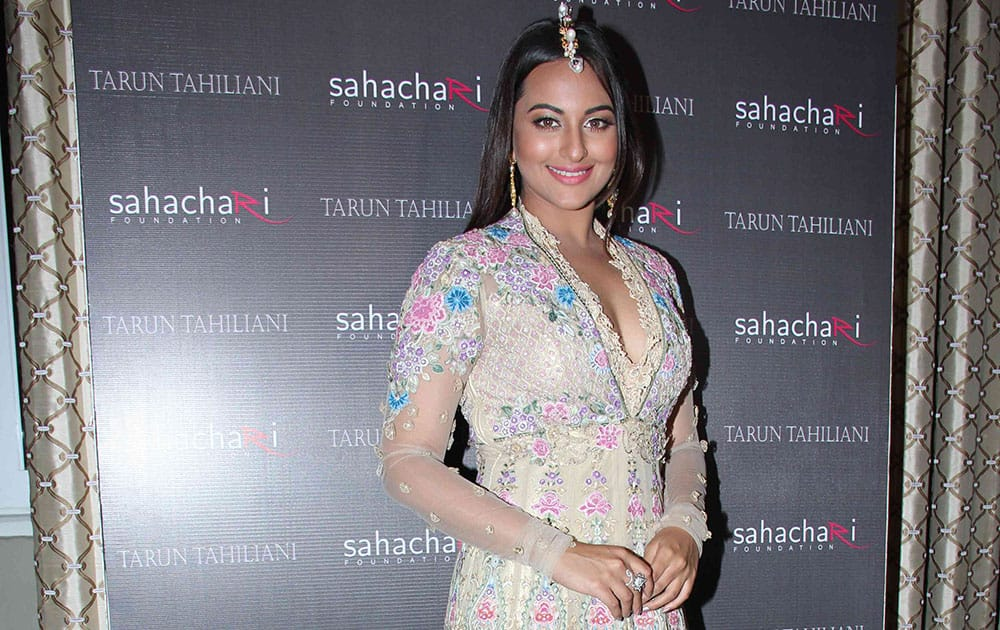 `SHOWSTOPPER: Sonakshi Sinha` walked the ramp for Tarun Tahiliani, who showcased his couture collection 'Modern Mughals' along with highlights from his AW'14 collection, in support of The Sahachari Foundation. -dna