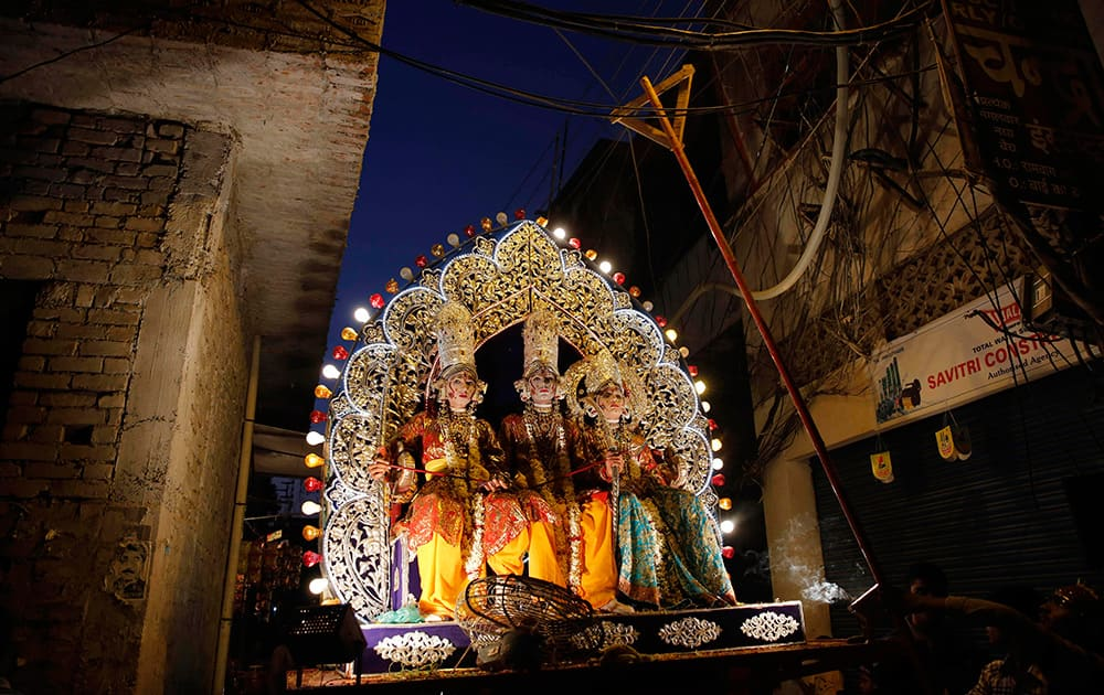 Artist dressed as Hindu gods take part on a Dussehra festival procession in Allahabad.