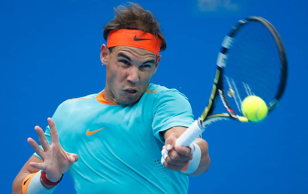 Rafael Nadal of Spain returns a shot from Richard Gasquet of France during the China Open tennis tournament at the National Tennis Stadium in Beijing, China.