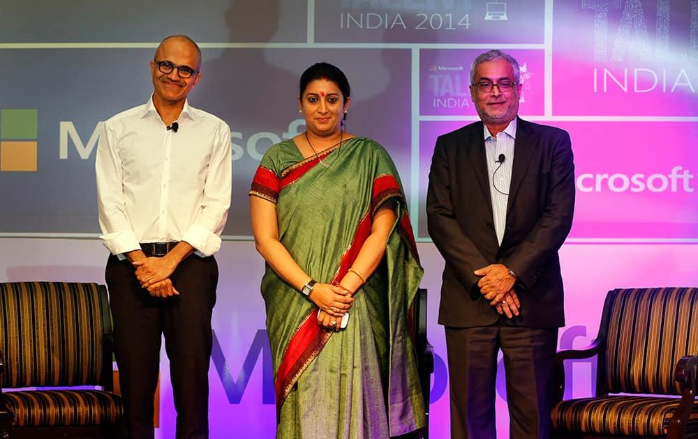 Chief Executive Officer of Microsoft Satya Nadella, Indian minister for Human Resource Development Smriti Irani and Chairman of Microsoft India Bhaskar Pramanik, pose for the media at the Talent India 2014 program in New Delhi.