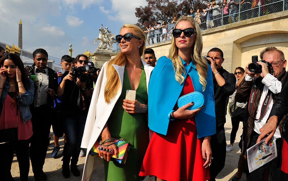 Paris and Nicky Hilton arrive at Valentino's Spring/Summer 2015 ready-to-wear fashion collection presented in Paris, France.