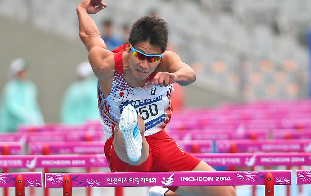 Japan's Akihoko Nakamura competes in the men's 110m hurdles heat two at the 17th Asian Games in Incheon, South Korea