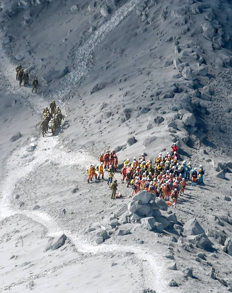 Rescuers conduct a search operation near the peak of Mount Ontake in central Japan.