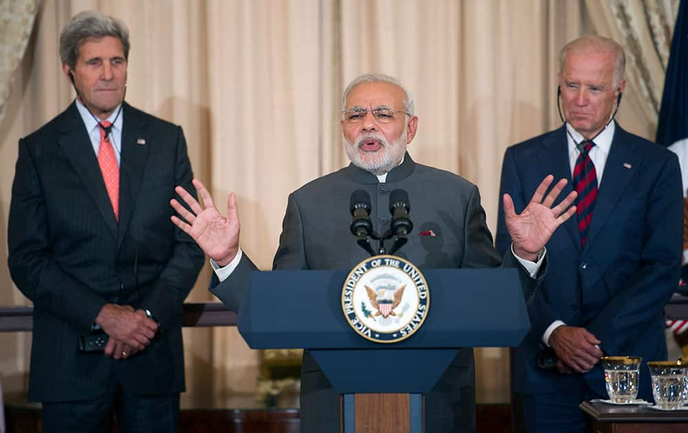 Indian Prime Minister Narendra Modi, center, flanked by Secretary of State John Kerry and Vice President Joe Biden, speaks during a luncheon in his honor, at the State Department in Washington.