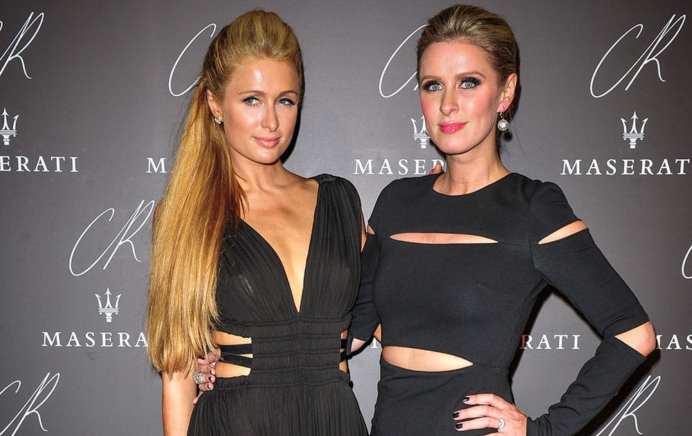 Paris Hilton,left, and Nicky Hilton pose at Carine Roitfeld & Stephen Gan celebration of the launch of CR Fashion Book N.5 in Paris.