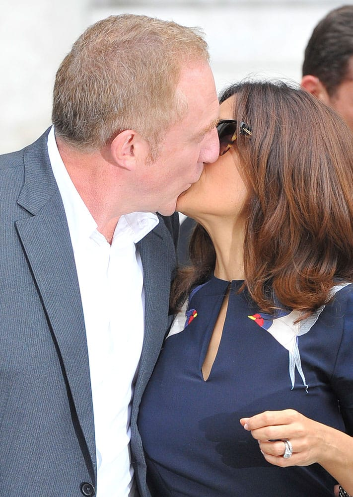 Mexican actress Salma Hayek kisses her husband Francois-Henri Pinault, CEO of luxury group Kering, after Stella McCartney's Spring/Summer 2015 ready-to-wear fashion collection presented in Paris.