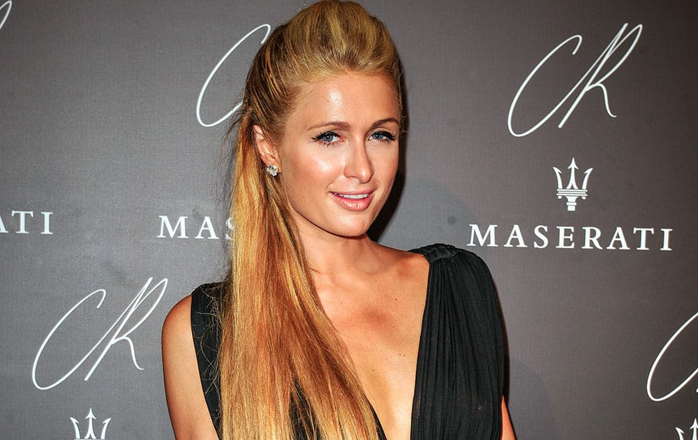 Paris Hilton poses at Carine Roitfeld & Stephen Gan celebration of the launch of CR Fashion Book N.5 in Paris.