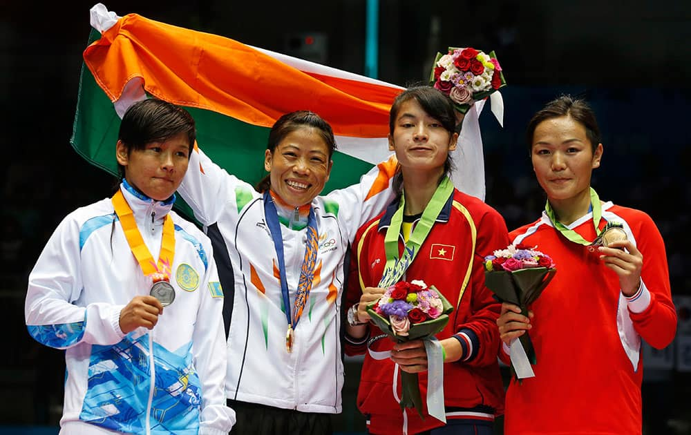 From left, silver medallist Kazakhstan's Zhaina Shekerbekova, gold medallist India's M.C. Mary Kom and bronze medallists Vietnam's Thi Bang Le and Mongolia's Nandintsetget Myagmardulam stand for the medal ceremony for the women's flyweight (48-51kg) boxing at the 17th Asian Games in Incheon, South Korea.