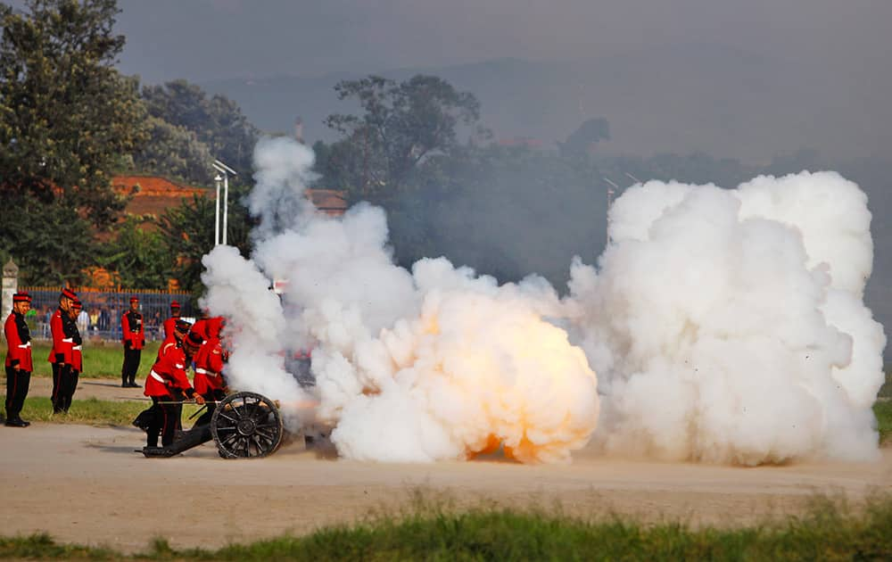 Nepalese army soldiers light a cannon on the seventh day of Hindu festival Dashain in Katmandu, Nepal.