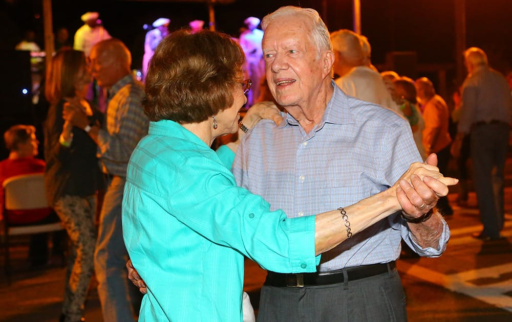 Former President Jimmy Carter and former first lady Rosalynn Carter dance on Main Street during the 18th Annual Plains Peanut Festival in Plains, Ga