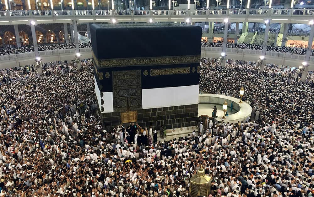 Muslim pilgrims moving around the Kaaba, the black cube at center, inside the Grand Mosque, a day before Muslim's annual pilgrimage, known as the Hajj, in the Muslim holy city of Mecca, Saudi Arabia.