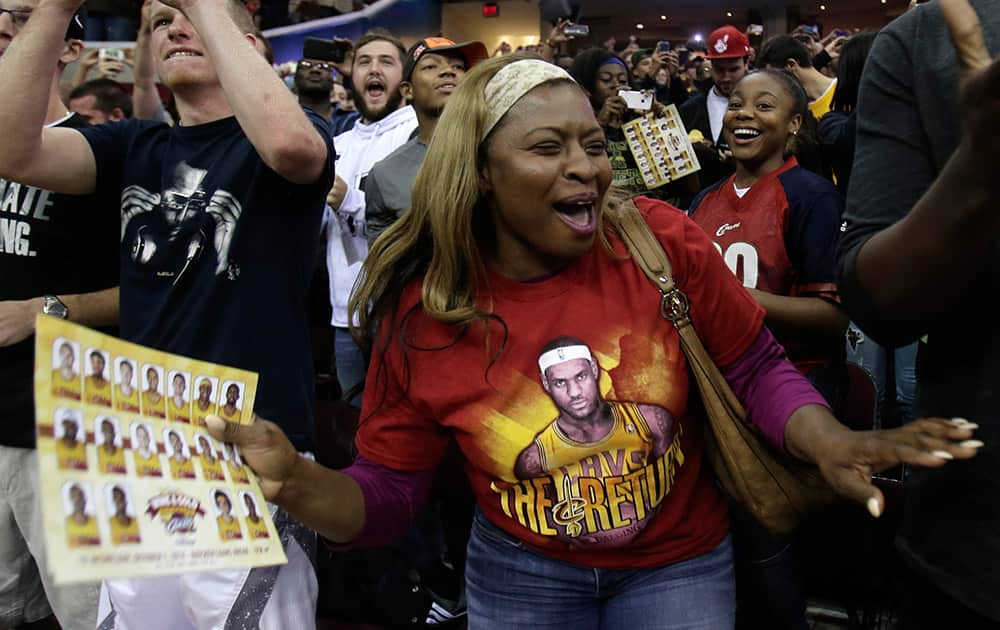 A Cleveland Cavaliers fan screams as the Cleveland Cavaliers are introduced during an NBA scrimmage basketball game.