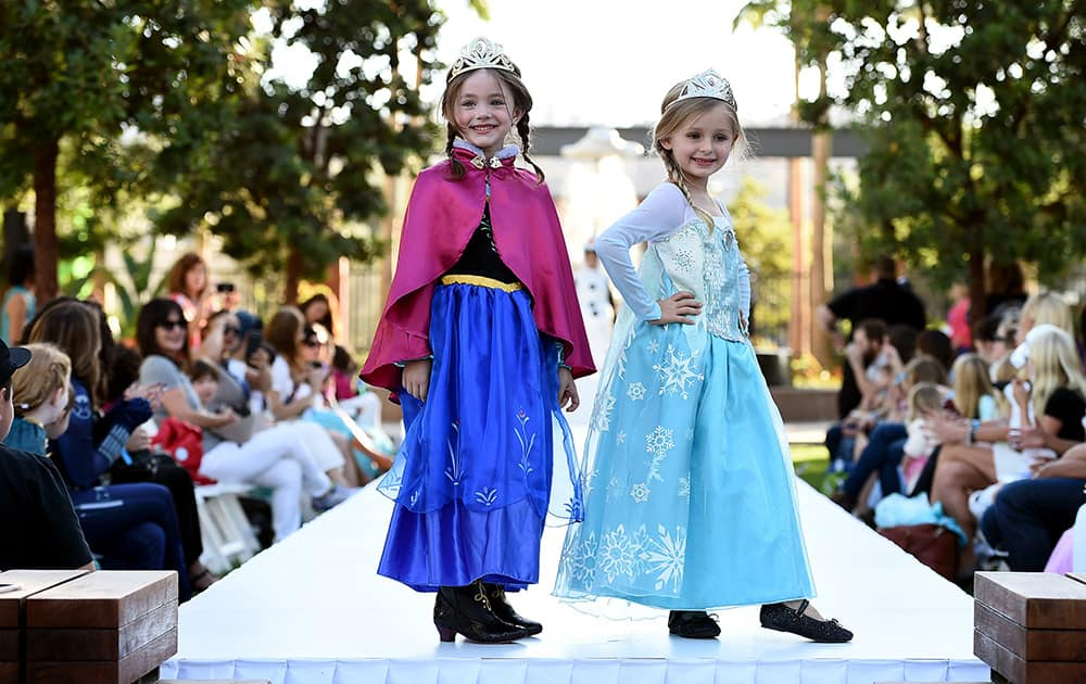 Models dressed up as  Anna and Elsa from Disney's 'Frozen' at Disney Consumer Products' VIP Halloween Fashion Show, in Glendale, Calif.