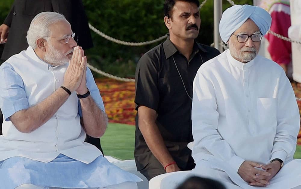 Prime Minister Narendra Modi and former PM Manmohan Singh at Rajghat on the occasion of Mahatma Gandhis 145th Birth Anniversary in New Delhi.