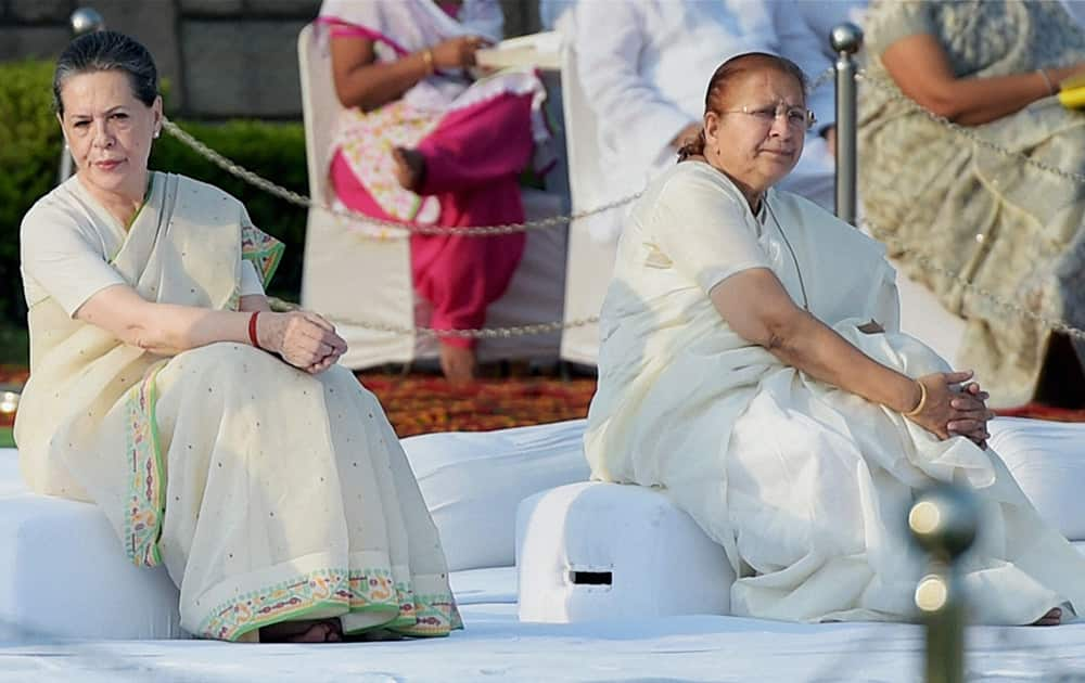 Congress President Sonia Gandhi and Lok Sabha Speaker Sumitra Mahajan at Rajghat on the occasion of Mahatma Gandhis 145th Birth Anniversary in New Delhi.