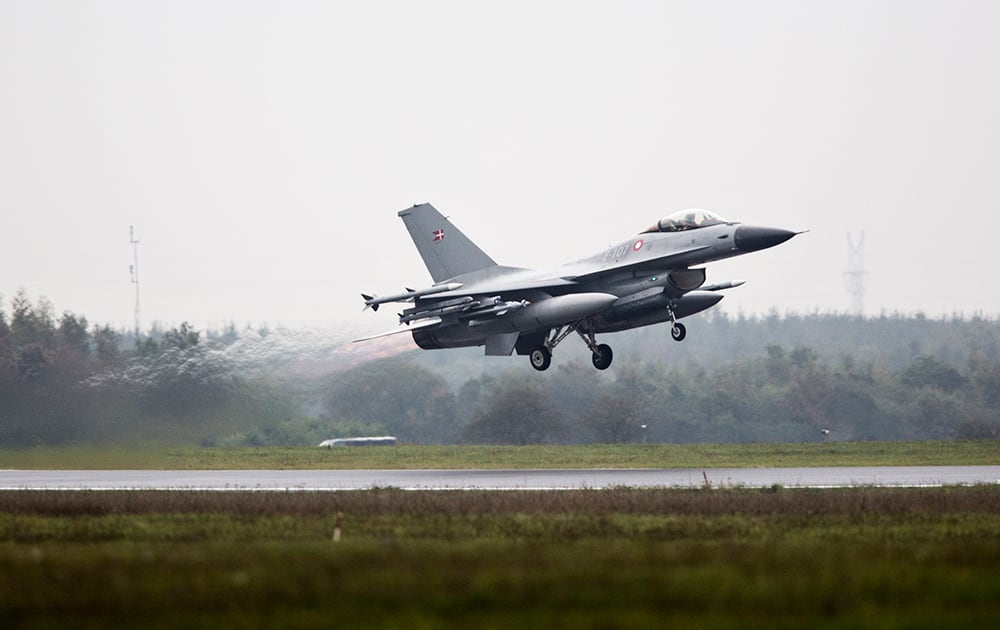 One of the seven Danish F-16 fighter jets takes off from military airport Flyvestation Skrydstrup in Jutland, Denmark.