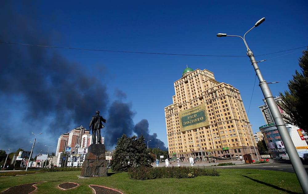 Smoke rises after shelling near the airport in the town of Donetsk, eastern Ukraine.
