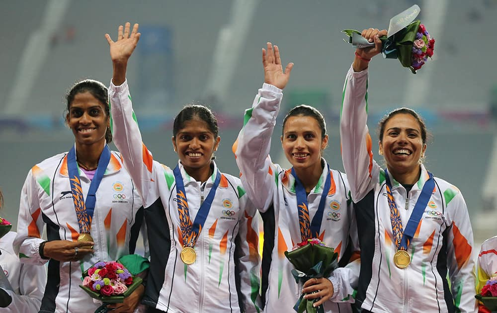 Indian team who won the gold wave during the medal ceremony of the womens 4 x 400m relay event at the 17th Asian Games in Incheon, South Korea.
