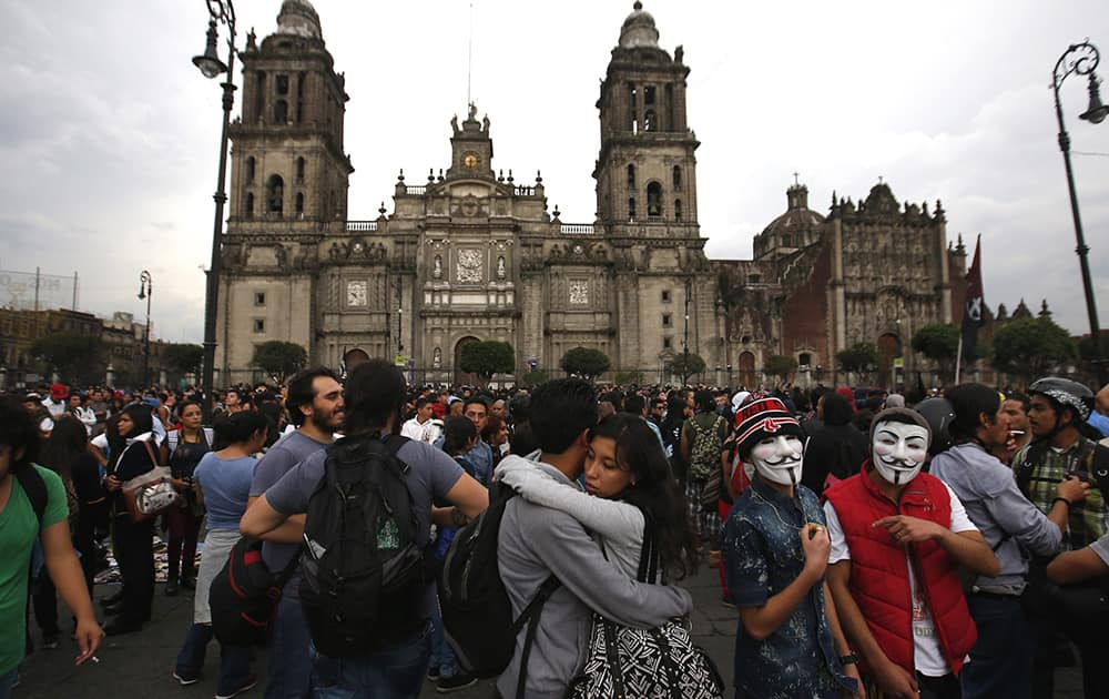 A young couple embraces during a march commemorating the anniversary of the Tlatelolco massacre, in the Zocalo, Mexico City's main square.