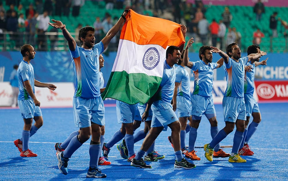 India's team celebrate after winning the men's gold medal hockey match against Pakistan at the 17th Asian Games in Incheon, South Korea.