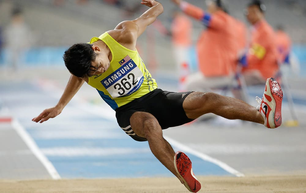 Malaysia's Muhammad Hakimi Bin Ismail competes in the men's triple jump final at the 17th Asian Games in Incheon.