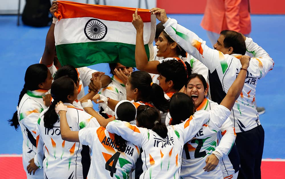 India's team celebrate after winning the women's team Kabaddi gold medal match at the 17th Asian Games in Incheon, South Korea.