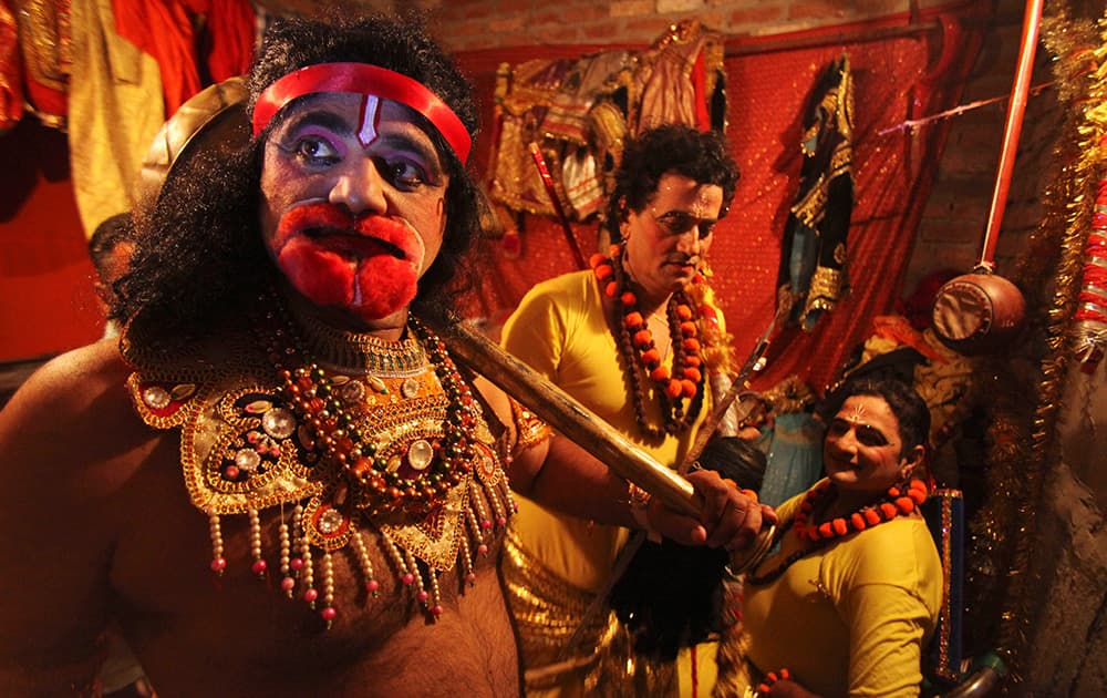Artists get ready backstage for 'Ramleela', a theater performance depicting the Hindu epic Ramayana as part of Dussehra festival celebrations.