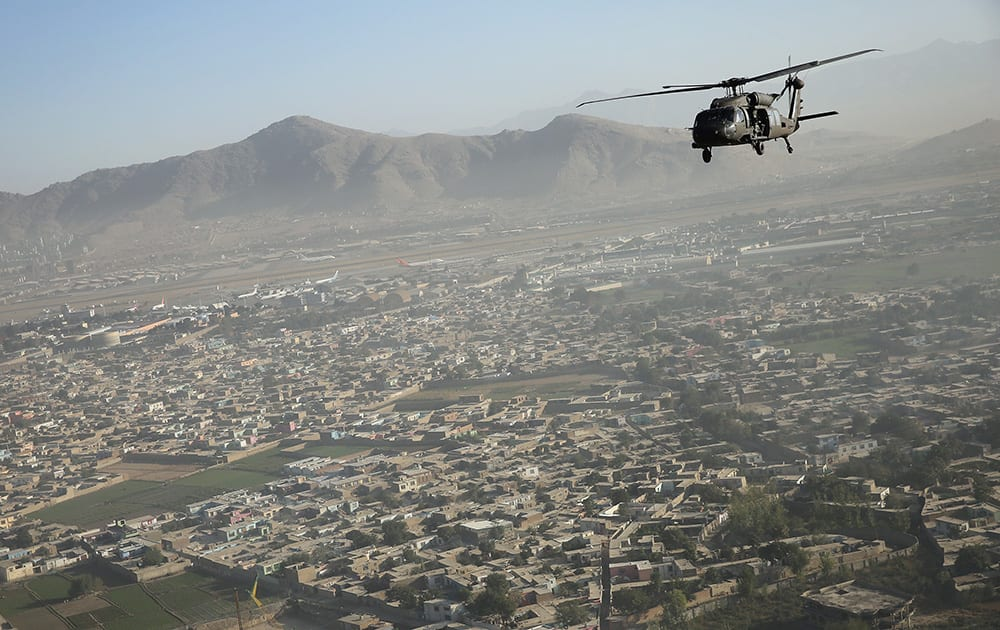 A Black Hawk flies over the city, during Britain's Prime Minister David Cameron visit, in Kabul, Afghanistan.