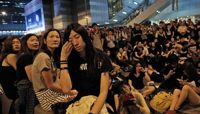 A protester reacts during a rally outside the government headquarters, after protesters threatened by residents and pro-Beijing supporters in Kowloon's crowded Mong Kok district, in Hong Kong.