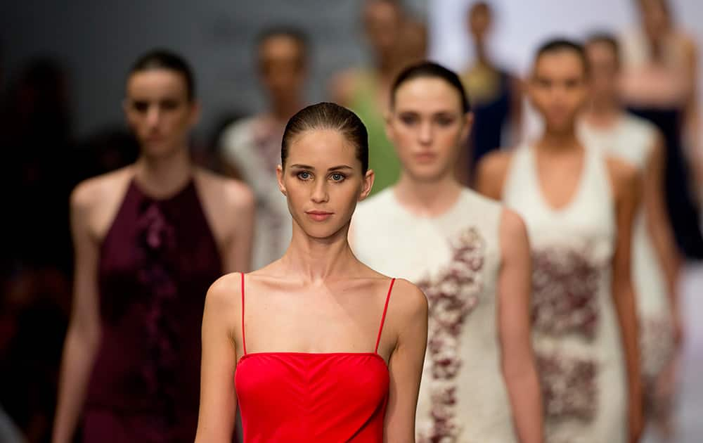Models wear creations by Mexico designer Macario Jimenez at the Mercedes Benz Fashion Week Mexico in Mexico City.