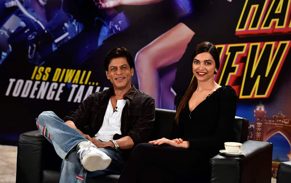 Bollywood actors Shah Rukh Khan and Deepika Padukone before the press conferance, mediapersons boycotted a press conference, which he was supposed to have held with actors Abhishek Bachchan, Deepika Padukone, Boman Irani and Sonu Sood for promoting their upcoming film 'Happy New Year.'