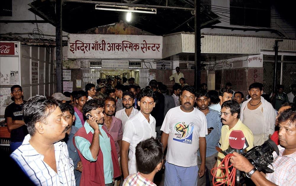People gather outside a hospital after stampede during Dussehra function in Patna Gandhi maidan.