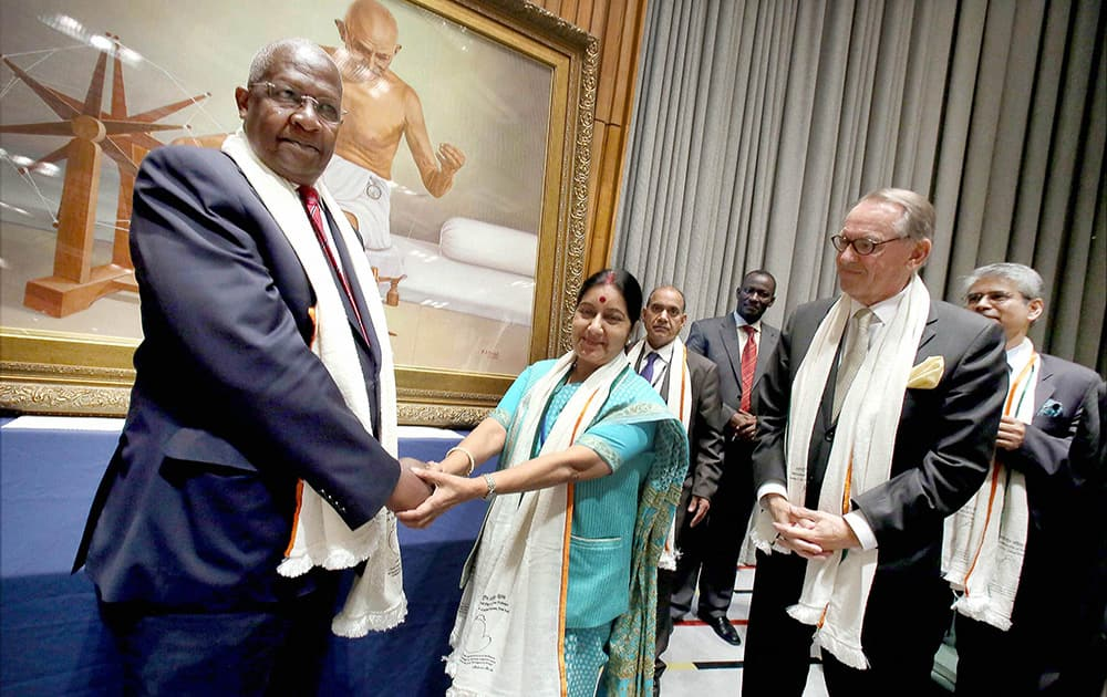 Sam Kutesa, President of the 69th UNGA and External Affairs Minister Sushma Swaraj at the unveiling of a painting of Mahatma Gandhi during the celebration of the International Day of Non-Violence at the United Nations in New York.